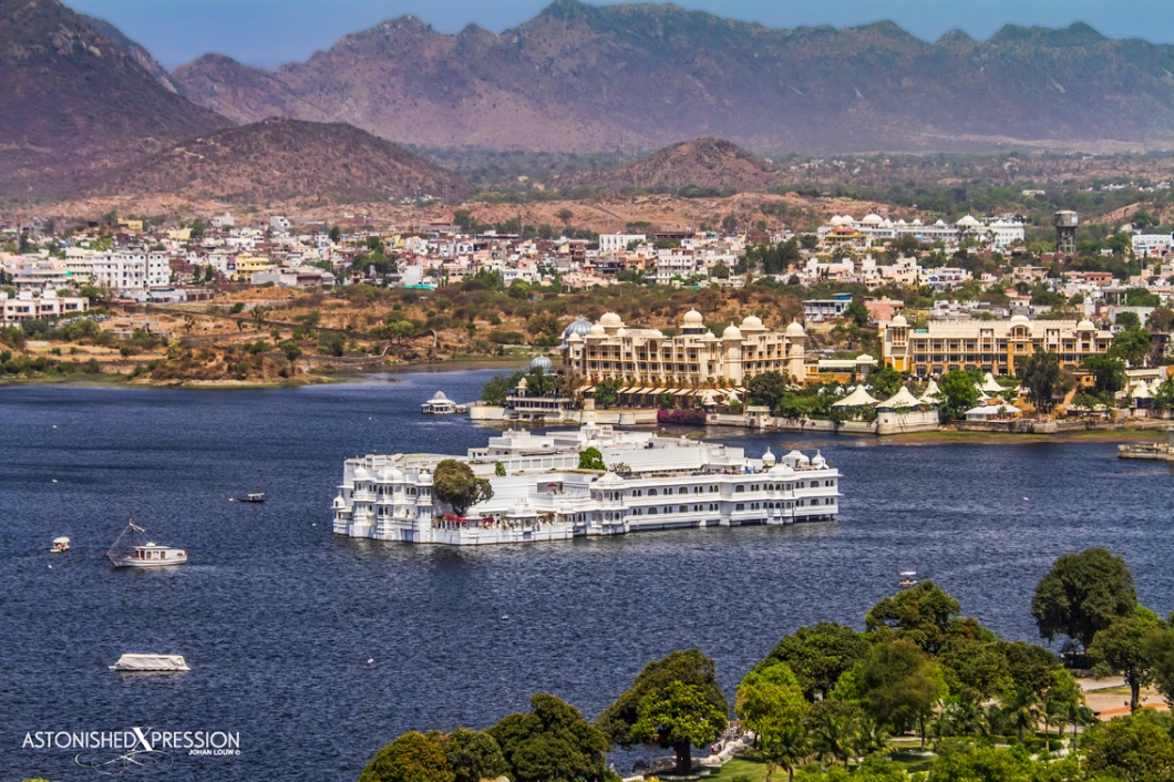 The luxurious Taj Lake Palace in Udaipur provides the focal point against the rolling Aravalli Range in the background